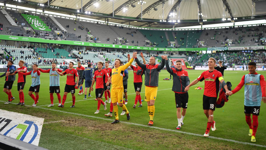 WOLFSBURG, GERMANY - SEPTEMBER 22:  Freiburg players celebrate their victory after the Bundesliga match between VfL Wolfsburg and Sport-Club Freiburg at Volkswagen Arena on September 22, 2018 in Wolfsburg, Germany.  (Photo by Stuart Franklin/Bongarts/Getty Images)