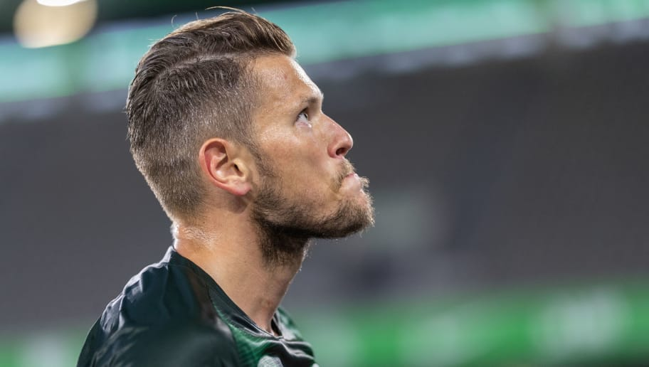 WOLFSBURG, GERMANY - AUGUST 11: Daniel Ginczek of VfL Wolfsburg looks on during the Pre Season friendly match between VfL Wolfsburg and SSC Napoli at Volkswagen Arena on August 11, 2018 in Wolfsburg, Germany. (Photo by Boris Streubel/Getty Images)