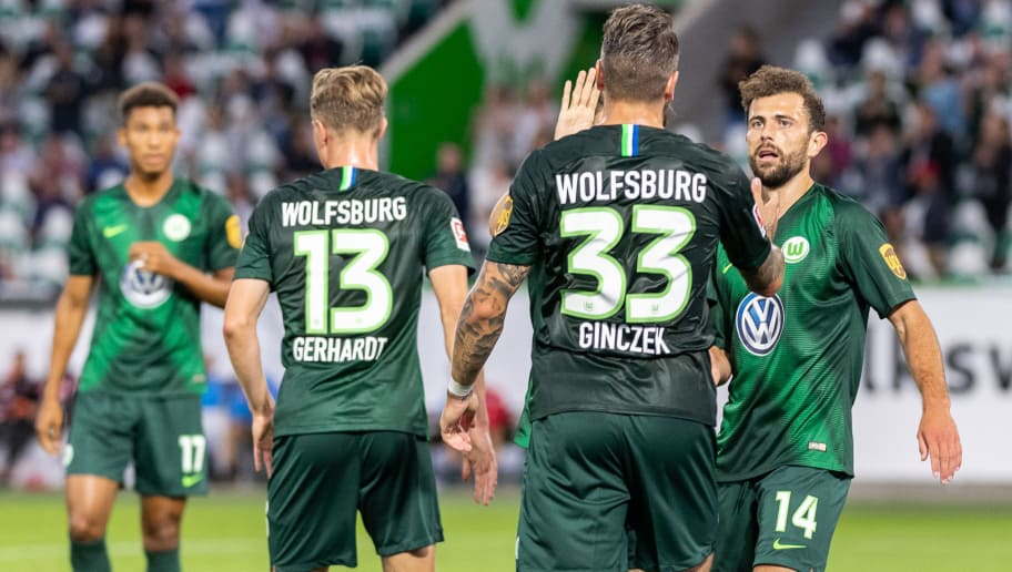 WOLFSBURG, GERMANY - AUGUST 11: Players of Wolfsburg celebrate during the Pre Season friendly match between VfL Wolfsburg and SSC Napoli at Volkswagen Arena on August 11, 2018 in Wolfsburg, Germany. (Photo by Boris Streubel/Getty Images)