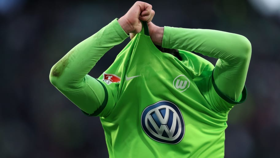 WOLFSBURG, GERMANY - MARCH 18: Christian Traesch of Wolfsburg takes off his jersey after the Bundesliga match between VfL Wolfsburg and SV Darmstadt 98 at Volkswagen Arena on March 18, 2017 in Wolfsburg, Germany. (Photo by Ronny Hartmann/Bongarts/Getty Images)