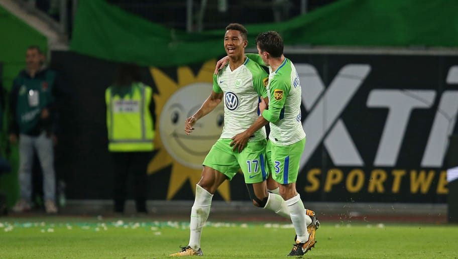 WOLFSBURG, GERMANY - OCTOBER 22: Ohis Felix Uduokhai of Wolfsburg celebrates after scoring his team`s first goal with team mates during the Bundesliga match between VfL Wolfsburg and TSG 1899 Hoffenheim at Volkswagen Arena on October 22, 2017 in Wolfsburg, Germany. (Photo by Martin Rose/Bongarts/Getty Images)