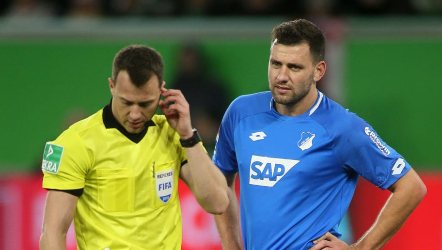 WOLFSBURG, GERMANY - DECEMBER 08: Referee Felix Zwayer talks to Adam Szalai of Hoffenheim during the Bundesliga match between VfL Wolfsburg and TSG 1899 Hoffenheim at Volkswagen Arena on December 8, 2018 in Wolfsburg, Germany. (Photo by Selim Sudheimer/Bongarts/Getty Images)