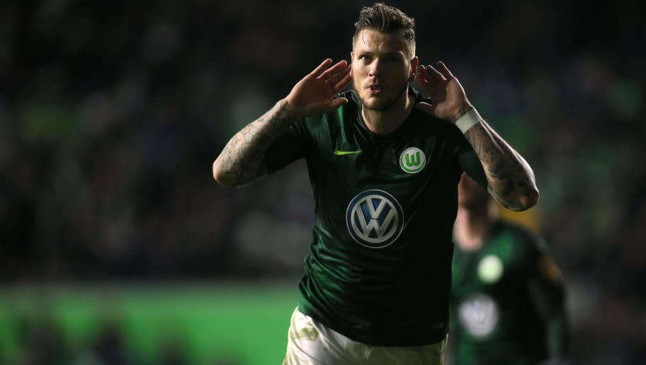 WOLFSBURG, GERMANY - DECEMBER 08: Daniel Ginczek of Wolfsburg celebrate their teams second goal scoring during the Bundesliga match between VfL Wolfsburg and TSG 1899 Hoffenheim at Volkswagen Arena on December 8, 2018 in Wolfsburg, Germany. (Photo by Selim Sudheimer/Bongarts/Getty Images)