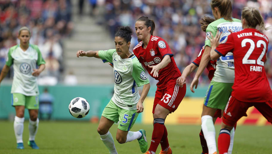 COLOGNE, GERMANY - MAY 19: Emily van Egmond of Wolfsburg (L) against Sara Daebritz of Muenchen during the Women's DFB Cup Final between VFL Wolfsburg and FC Bayern Muenchen at RheinEnergieStadion on May 19, 2018 in Cologne, Germany. (Photo by Mika Volkmann/Bongarts/Getty Images)
