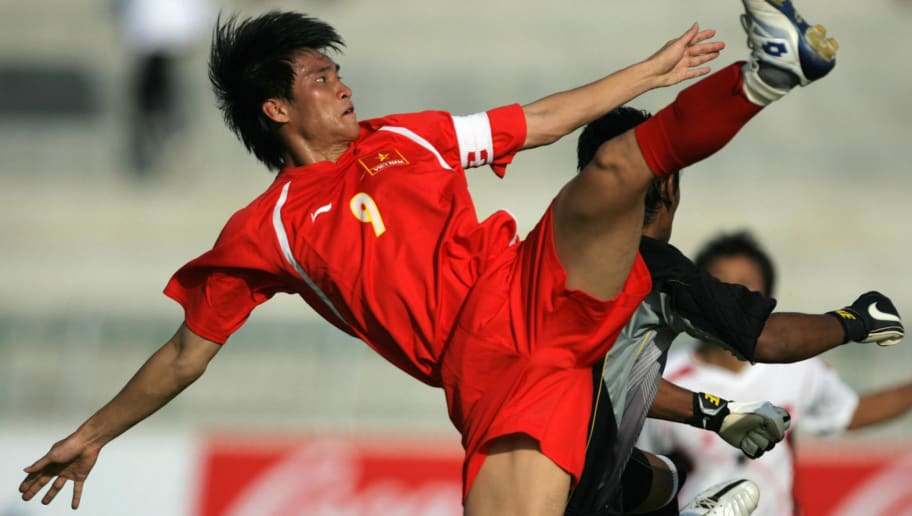 Vietnamese soccer captain Vinh Le Cong Win (L) fight for the ball with Myanmar's goal keeper Zin Htet Kyaw (1) during the men's football semifinal of the 24th Southeast Asian Games (SEA Games) in Korat, 11 December 2007. Myanmar won a place in the final after defeating Vietnam 3-1. AFP PHOTO/Bay ISMOYO (Photo credit should read BAY ISMOYO/AFP/Getty Images)