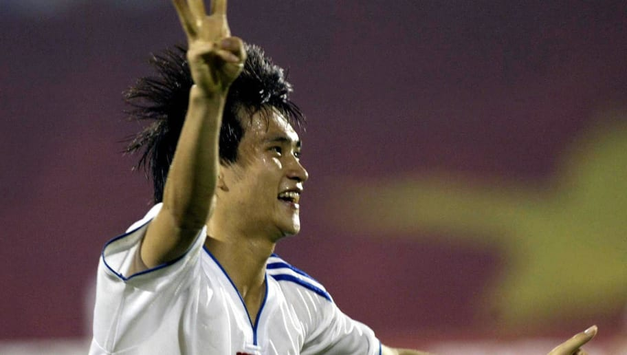 HO CHI MINH CITY, VIET NAM:  Vietnamese striker Le Cong Vinh (#9) jubilates after scoring the 9th and final goal for Vietnam during the Tiger soccer Southeast Asian Championship match between Vietnam and Cambodia at Ho Chi Minh-city's Thong Nhat stadium, 09 December 2004.  Vietnam won 9-1.  AFP PHOTO/HOANG DINH Nam   (Photo credit should read HOANG DINH NAM/AFP/Getty Images)