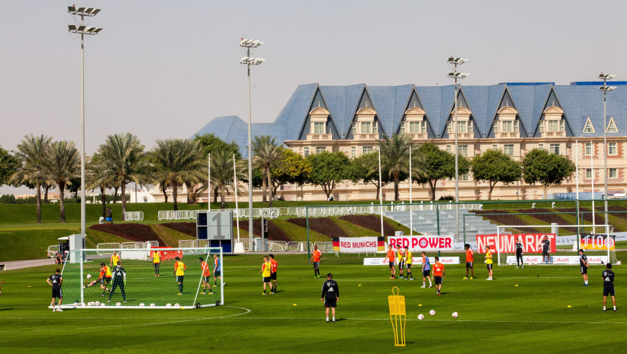 DOHA, QATAR - JANUARY 06:  View of the trainings ground and the Grand Hertitage hotel is taken at the ASPIRE Academy for Sports Excellence on January 6, 2013 in Doha, Qatar. ASPIRE Zone, also knowmn as Doha Sports City which is an huge area of 250 hectar including 10 football trainings grounds, big indoor arena for football, track and field, basketball and so on, as well as a big swimming pool with olympic measure and two hotels called The Torch and The Grand Heritage. The two German Bundesliga clubs FC Bayern Muenchen and Schalke 04 place their winter training camp there every January. The Khalifa International football stadium is also placed at Aspire Zone. The FIFA World Cup 2022 will take place in Qatar.  (Photo by Nadine Rupp/Getty Images)