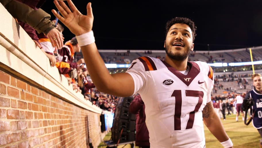 CHARLOTTESVILLE, VA - NOVEMBER 24: Josh Jackson #17 of the Virginia Tech Hokies celebrates with fans after a game against the Virginia Cavaliers at Scott Stadium on November 24, 2017 in Charlottesville, Virginia. Virginia Tech defeated Virginia 10-0. (Photo by Ryan M. Kelly/Getty Images)