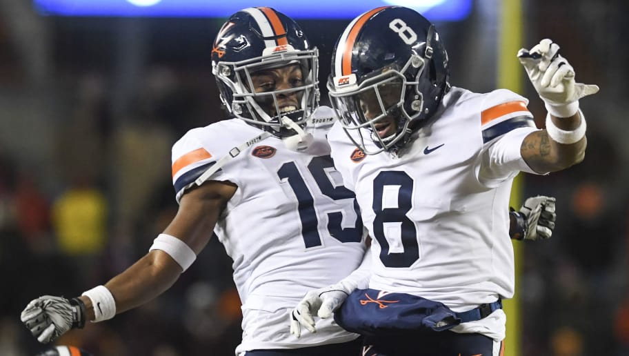 BLACKSBURG, VA - NOVEMBER 23: Wide receiver Hasise Dubois #8 of the Virginia Cavaliers celebrates his touchdown reception against the Virginia Tech Hokies with wide receiver Chuck Davis #19 in the second half at Lane Stadium on November 23, 2018 in Blacksburg, Virginia. (Photo by Michael Shroyer/Getty Images)