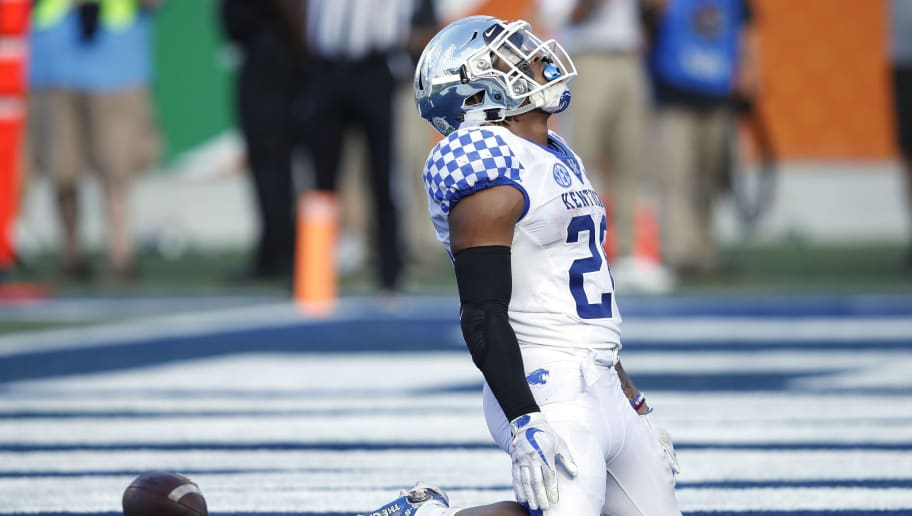 ORLANDO, FL - JANUARY 01: Benny Snell Jr. #26 of the Kentucky Wildcats reacts after rushing for a 12-yard touchdown against the Penn State Nittany Lions in the third quarter of the VRBO Citrus Bowl at Camping World Stadium on January 1, 2019 in Orlando, Florida. (Photo by Joe Robbins/Getty Images)
