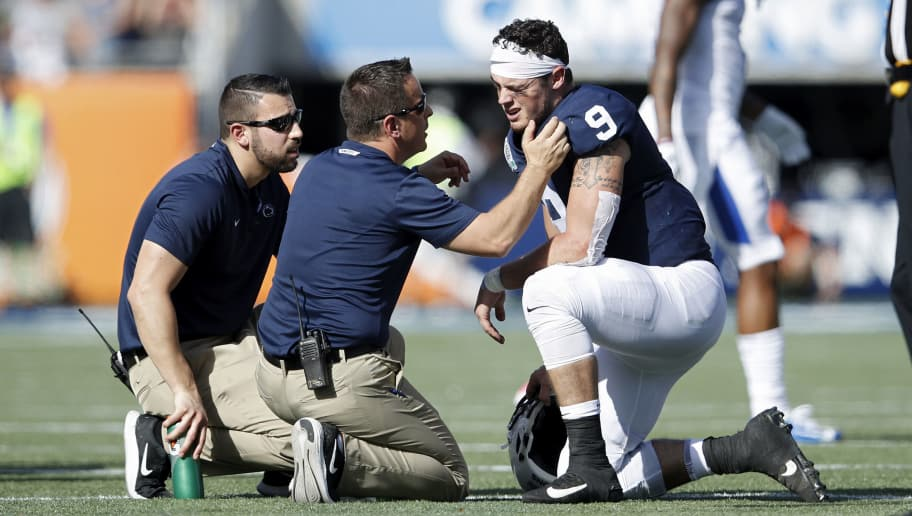 ORLANDO, FL - JANUARY 01: Trace McSorley #9 of the Penn State Nittany Lions is checked out after suffering an injury against the Kentucky Wildcats in the second quarter of the VRBO Citrus Bowl at Camping World Stadium on January 1, 2019 in Orlando, Florida. (Photo by Joe Robbins/Getty Images)