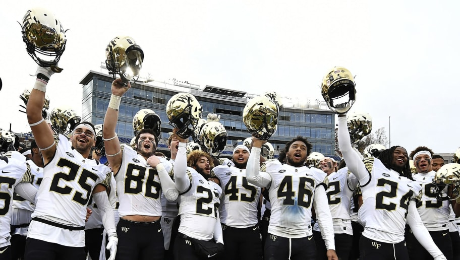DURHAM, NORTH CAROLINA - NOVEMBER 24: The Wake Forest Demon Deacons celebrate their victory over the Duke Blue Devils following their football game at Wallace Wade Stadium on November 24, 2018 in Durham, North Carolina. (Photo by Mike Comer/Getty Images)