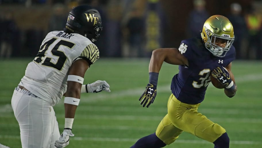 SOUTH BEND, IN - NOVEMBER 04:  Deon McIntosh #38 of the Notre Dame Fighting Irish is chased by Paris Black #45 of the Wake Forest Demon Deacons at Notre Dame Stadium on November 4, 2017 in South Bend, Indiana. Notre Dame defeated Wake Forest 48-37.(Photo by Jonathan Daniel/Getty Images)