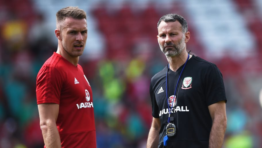 WREXHAM, WALES - MAY 21: Ryan Giggs manager of Wales talks to Aaron Ramsey during a training session a the Racecourse Ground on May 21, 2018 in Wrexham, Wales. (Photo by Nathan Stirk/Getty Images)