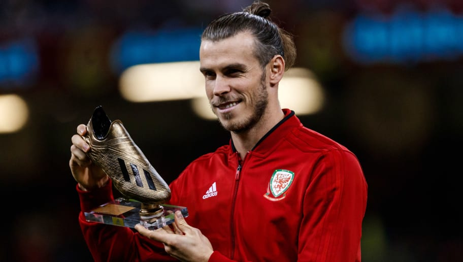 CARDIFF, WALES - OCTOBER 11: Gareth Bale of Wales is presented with a Golden Boot at half time during the International Friendly match between Wales and Spain on October 11, 2018 in Cardiff, United Kingdom. (Photo by TF-Images/Getty Images)