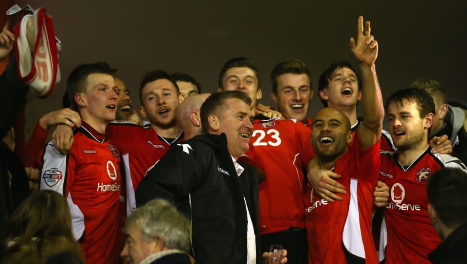 WALSALL, ENGLAND - JANUARY 27:  Dean Smith (C) the manager of Walsall flanked by James Chambers (2R) celebrate reaching the final after their 2-0 victory during the Johnstone's Paint Northern Area Final second leg match between Walsall and Preston North End at Banks' Stadium on January 27, 2015 in Walsall, England.  (Photo by Michael Steele/Getty Images)