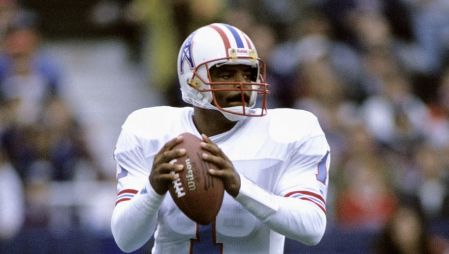 Houston Oilers Hall of Fame quarterback Warren Moon (1) scans the field during a 28-14 victory over the New England Patriots on October 17, 1993, at Foxboro Stadium in Foxboro, Massachusetts. (Photo by Allen Kee/Getty Images) *** Local Caption ***