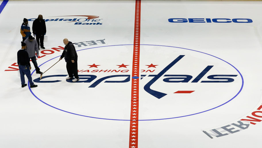 WASHINGTON, DC - JANUARY 09:  Workers paint the ice and put down logos for the Washington Capitals at Verizon Center on January 9, 2013 in Washington, DC.  (Photo by Rob Carr/Getty Images)