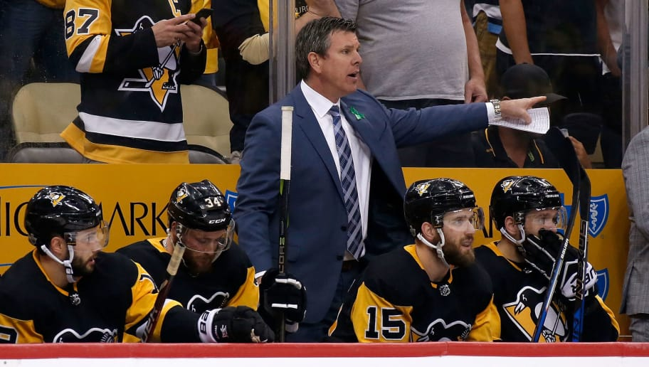 PITTSBURGH, PA - MAY 03:  Head coach Mike Sullivan of the Pittsburgh Penguins gives directions to his players during a timeout in Game Four of the Eastern Conference Second Round during the 2018 NHL Stanley Cup Playoffs against the Washington Capitals at PPG PAINTS Arena on May 3, 2018 in Pittsburgh, Pennsylvania. Pittsburgh defeated Washington 3-1. (Photo by Kirk Irwin/Getty Images) *** Local Caption *** Mike Sullivan