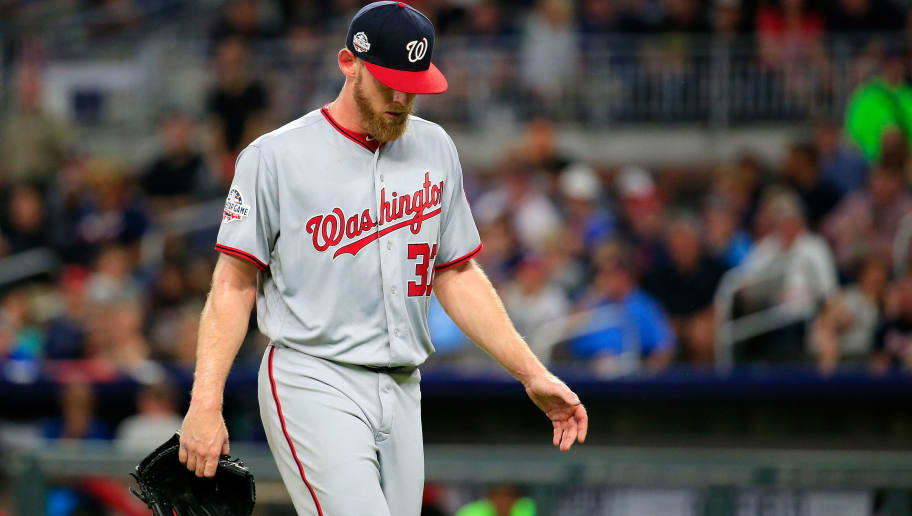 ATLANTA, GA - JUNE 01: Stephen Strasburg #37 of the Washington Nationals looks at his injured hand before leaves the game with an injury during the seventh inning against the Atlanta Braves at SunTrust Park on June 1, 2018 in Atlanta, Georgia. (Photo by Daniel Shirey/Getty Images)