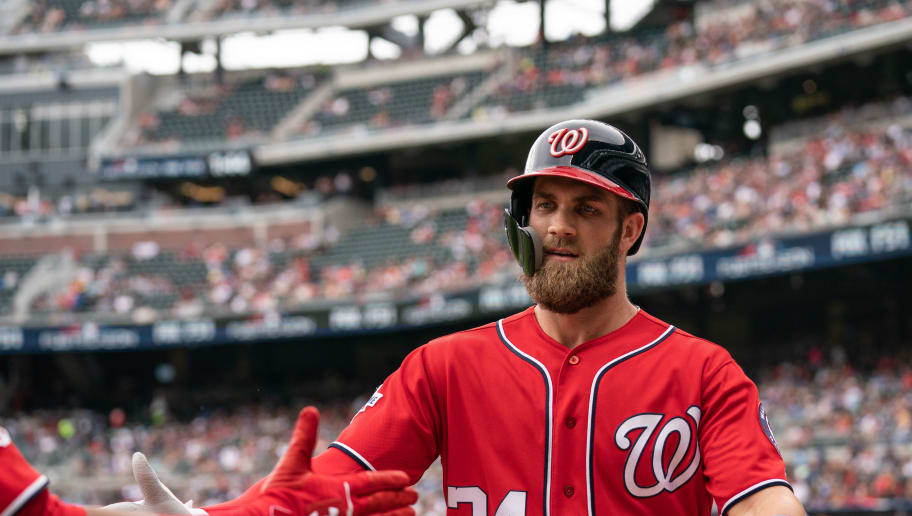 ATLANTA, GA - SEPTEMBER 16: Bryce Harper #34 of the Washington Nationals is greeted with high fives by teammates after hitting a two run home run in the first inning agains the Atlanta Braves at SunTrust Park on September 16, 2018 in Atlanta, Georgia.(Photo by Kelly Kline/Getty Images)