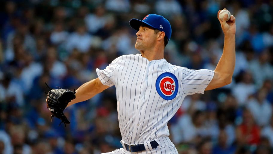 CHICAGO, IL - AUGUST 12:  Cole Hamels #35 of the Chicago Cubs pitches against the Washington Nationals during the first inning at Wrigley Field on August 12, 2018 in Chicago, Illinois.  (Photo by Jon Durr/Getty Images)
