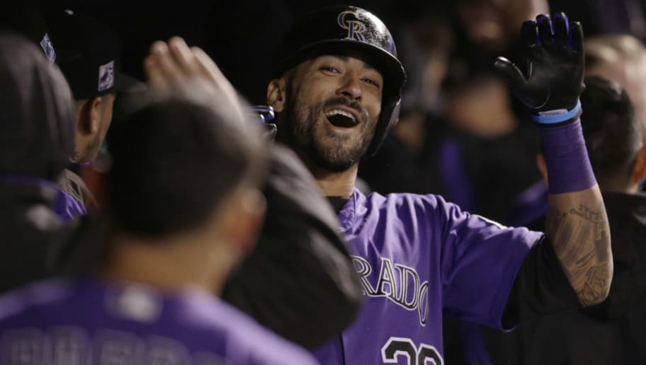 DENVER, CO - SEPTEMBER 28: Ian Desmond #20 of the Colorado Rockies celebrates his two-run home run against the Washington Nationals in the dugout in the fifth inning at Coors Field on September 28, 2018 in Denver, Colorado. (Photo by Joe Mahoney/Getty Images)
