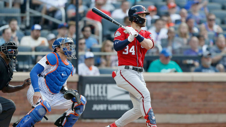 NEW YORK, NY - JULY 14:  Bryce Harper #34 of the Washington Nationals follows through on a sixth inning RBI single against the New York Mets at Citi Field on July 14, 2018 in the Flushing neighborhood of the Queens borough of New York City.  (Photo by Jim McIsaac/Getty Images)