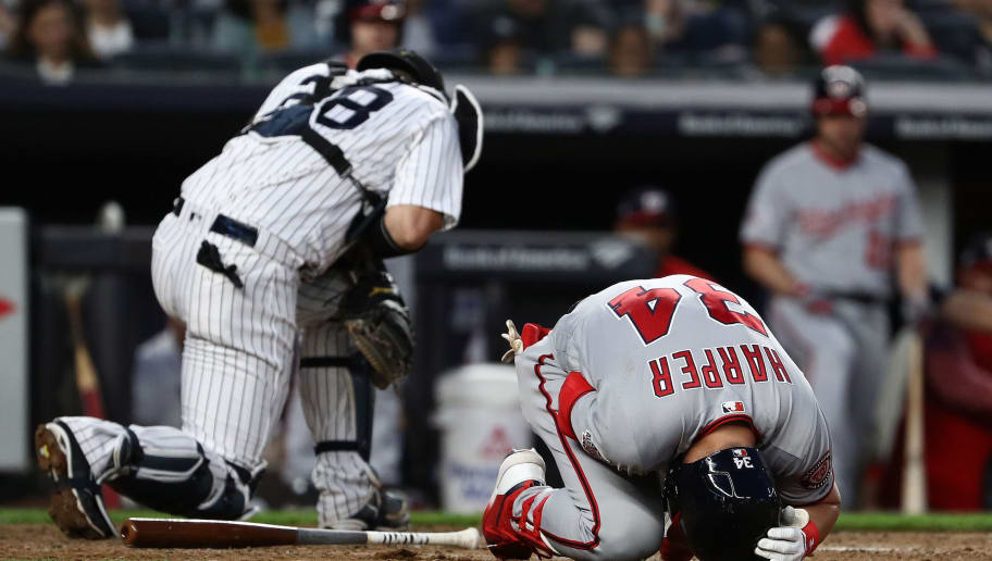 NEW YORK, NY - JUNE 12:  Bryce Harper #34 of the Washington Nationals reacts after being hit by a pitch by CC Sabathia #52 of the New York Yankees in the fifth inning during their game at Yankee Stadium on June 12, 2018 in New York City.  (Photo by Al Bello/Getty Images)