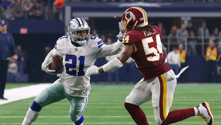 ARLINGTON, TEXAS - NOVEMBER 22: Ezekiel Elliott #21 of the Dallas Cowboys holds off Mason Foster #54 of the Washington Redskins on a run in the fourth quarter at AT&T Stadium on November 22, 2018 in Arlington, Texas. (Photo by Richard Rodriguez/Getty Images)