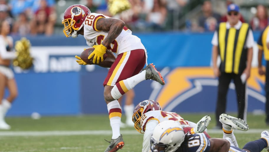 CARSON, CA - DECEMBER 10:  Cornerback Bashaud Breeland #26 of the Washington Redskins takes off on a 96 yard return for a touchdown after his interception in the fourth quarter against the Los Angeles Chargers on December 10, 2017 at StubHub Center in Carson, California.  The Chargers won 30-16.  (Photo by Stephen Dunn/Getty Images)