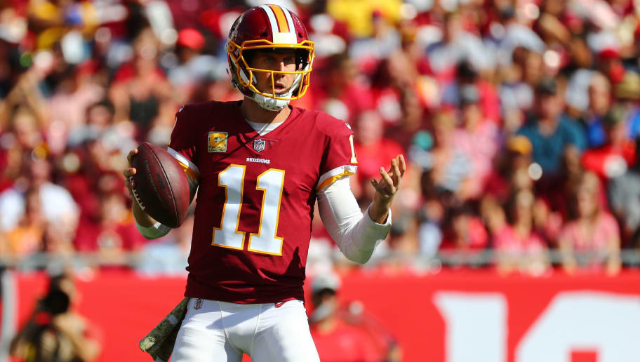 TAMPA, FLORIDA - NOVEMBER 11: Alex Smith #11 of the Washington Redskins looks surprised by a false start penalty during the second quarter against the Tampa Bay Buccaneers at Raymond James Stadium on November 11, 2018 in Tampa, Florida. (Photo by Will Vragovic/Getty Images)