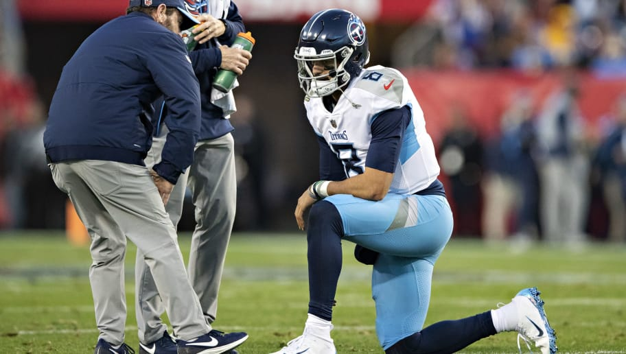 NASHVILLE, TN - DECEMBER 22:  Marcus Mariota #8 of the Tennessee Titans rests on one knee after a hard tackle during a game against the Washington Redskins at Nissan Stadium on December 22, 2018 in Nashville, Tennessee.  The Titans defeated the Redskins 25-16.   (Photo by Wesley Hitt/Getty Images)