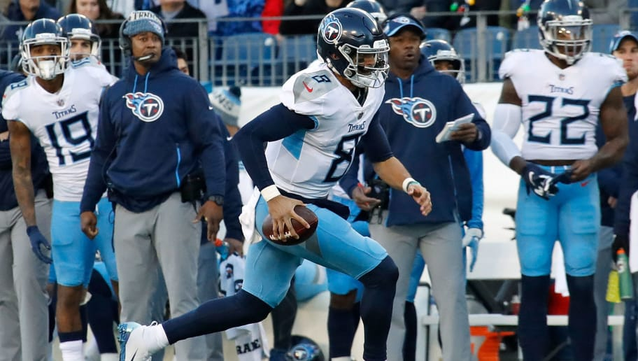 NASHVILLE, TN - DECEMBER 22: Quarterback Marcus Mariota #8 of the Tennessee Titans rushes against the Washington Redskins at Nissan Stadium on December 22, 2018 in Nashville, Tennessee.  (Photo by Frederick Breedon/Getty Images)