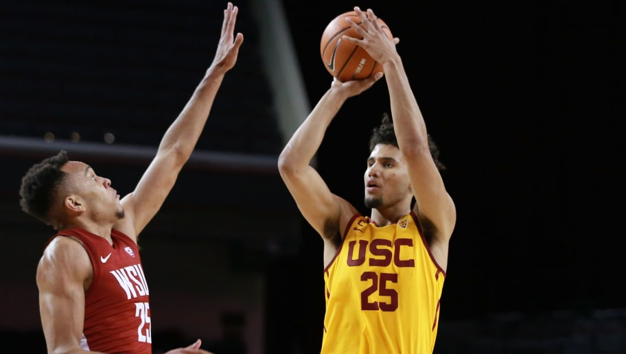 LOS ANGELES, CA - DECEMBER 31:  Bennie Boatwright #25 of the USC Trojans handles the ball against Arinze Chidom #25 of the Washington State Cougars during a PAC12 college basketball game at Galen Center on December 31, 2017 in Los Angeles, California.  (Photo by Leon Bennett/Getty Images)