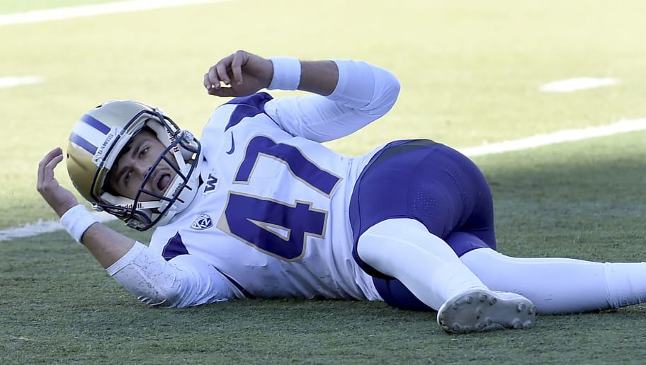 GENE, OR - OCTOBER 13: Place kicker Peyton Henry #47 of the Washington Huskies falls to the turf goal after his field attempt to win the game misses in the final seconds of the regulation against the Oregon Ducks at Autzen Stadium on October 13, 2018 in Eugene, Oregon. The Ducks won the game in overtime 30-27. (Photo by Steve Dykes/Getty Images)