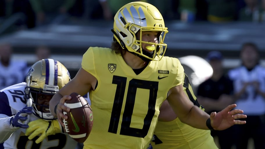 EUGENE, OR - OCTOBER 13:  Quarterback Justin Herbert #10 of the Oregon Ducks scrambles in the first half of the game at Autzen Stadium on October 13, 2018 in Eugene, Oregon. The Ducks won the game 30-27.  (Photo by Steve Dykes/Getty Images)