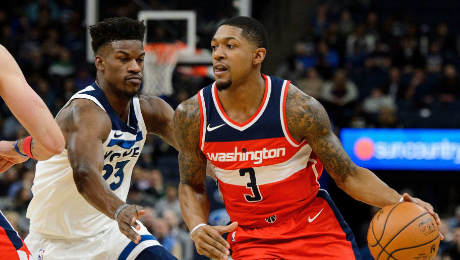 MINNEAPOLIS, MN - NOVEMBER 28: Bradley Beal #3 of the Washington Wizards drives to the basket against Jimmy Butler #23 of the Minnesota Timberwolves during the game on November 28, 2017 at the Target Center in Minneapolis, Minnesota. NOTE TO USER: User expressly acknowledges and agrees that, by downloading and or using this Photograph, user is consenting to the terms and conditions of the Getty Images License Agreement. (Photo by Hannah Foslien/Getty Images)