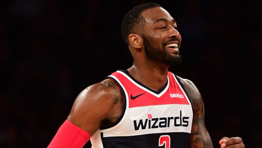 NEW YORK, NEW YORK - DECEMBER 03: John Wall #2 of the Washington Wizards reacts during the third quarter of the game against New York Knicks at Madison Square Garden on December 03, 2018 in New York City. NOTE TO USER: User expressly acknowledges and agrees that, by downloading and or using this photograph, User is consenting to the terms and conditions of the Getty Images License Agreement. (Photo by Sarah Stier/Getty Images)