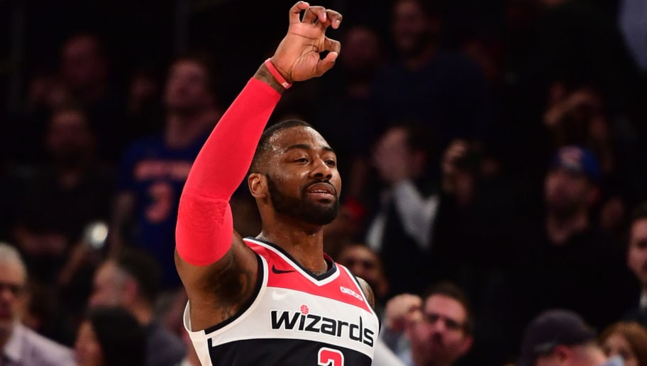 NEW YORK, NEW YORK - DECEMBER 03: John Wall #2 of the Washington Wizards reacts after scoring a basket in the final seconds of the fourth quarter of the game against New York Knicks at Madison Square Garden on December 03, 2018 in New York City. NOTE TO USER: User expressly acknowledges and agrees that, by downloading and or using this photograph, User is consenting to the terms and conditions of the Getty Images License Agreement. (Photo by Sarah Stier/Getty Images)