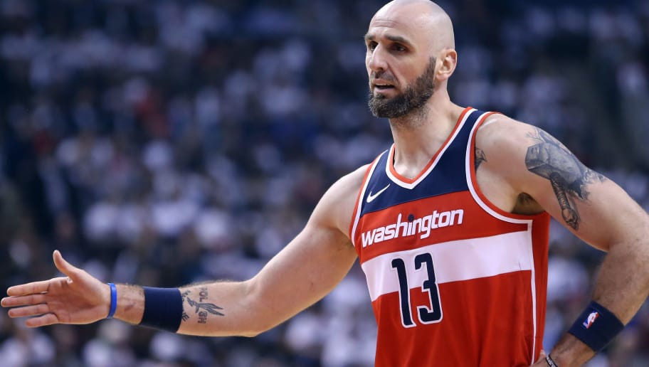 TORONTO, ON - APRIL 25:  Marcin Gortat #13 of the Washington Wizards high fives during the first half of Game Five against the Toronto Raptors in Round One of the 2018 NBA playoffs at Air Canada Centre on April 25, 2018 in Toronto, Canada.  NOTE TO USER: User expressly acknowledges and agrees that, by downloading and or using this photograph, User is consenting to the terms and conditions of the Getty Images License Agreement.  (Photo by Vaughn Ridley/Getty Images)'n
