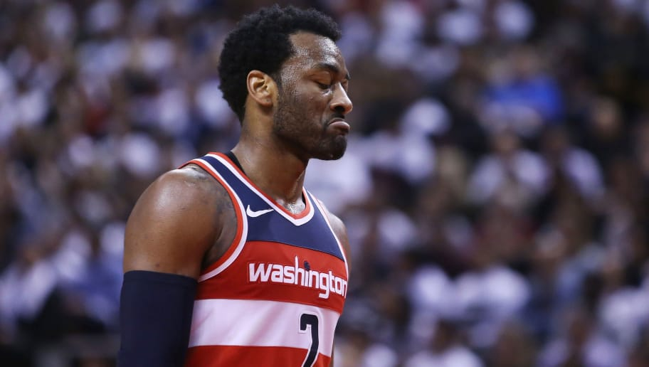 TORONTO, ON - APRIL 25:  John Wall #2 of the Washington Wizards looks on during the second half of Game Five against the Toronto Raptors in Round One of the 2018 NBA playoffs at Air Canada Centre on April 25, 2018 in Toronto, Canada.  NOTE TO USER: User expressly acknowledges and agrees that, by downloading and or using this photograph, User is consenting to the terms and conditions of the Getty Images License Agreement.  (Photo by Vaughn Ridley/Getty Images)'n