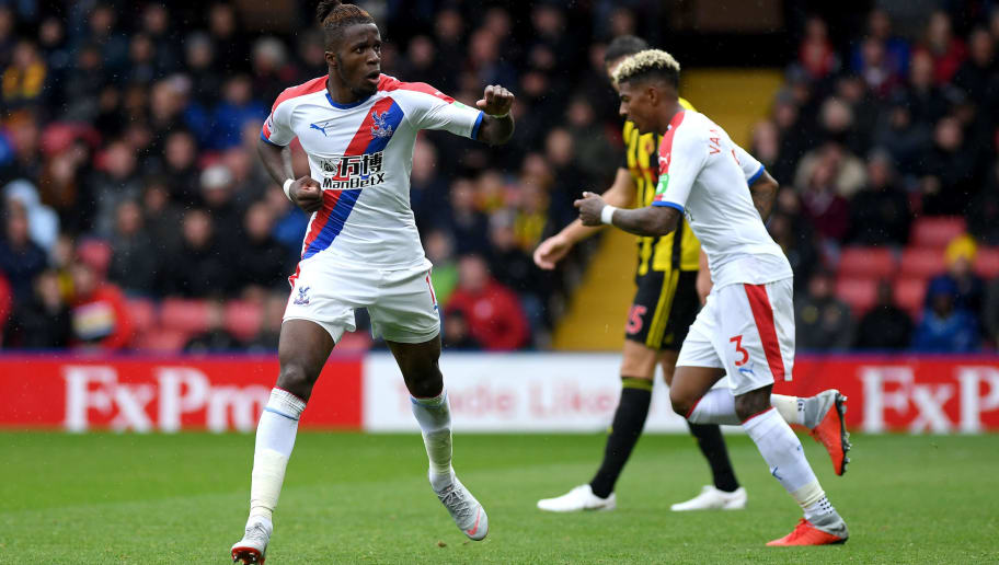 WATFORD, ENGLAND - AUGUST 26:  Wilfried Zaha of Crystal Palace celebrates after scoring his team's first goal during the Premier League match between Watford FC and Crystal Palace at Vicarage Road on August 26, 2018 in Watford, United Kingdom.  (Photo by Mike Hewitt/Getty Images)