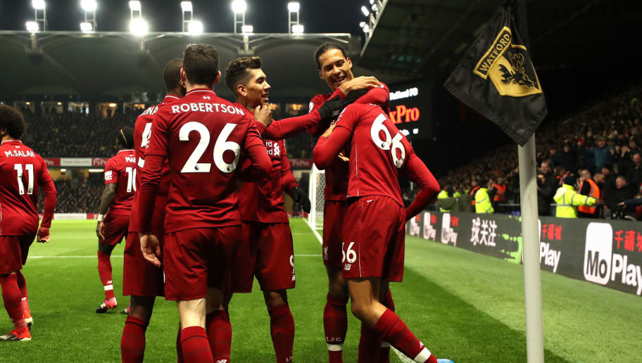 WATFORD, ENGLAND - NOVEMBER 24:  Trent Alexander-Arnold of Liverpool celebrates with teammates after scoring his team's second goal during the Premier League match between Watford FC and Liverpool FC at Vicarage Road on November 24, 2018 in Watford, United Kingdom.  (Photo by Richard Heathcote/Getty Images)