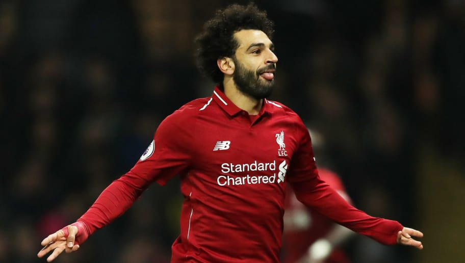 WATFORD, ENGLAND - NOVEMBER 24:  Mohamed Salah of Liverpool celebrates after scoring his team's first goal during the Premier League match between Watford FC and Liverpool FC at Vicarage Road on November 24, 2018 in Watford, United Kingdom.  (Photo by Richard Heathcote/Getty Images)