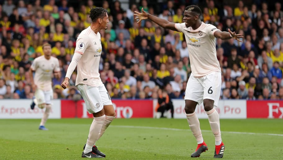 WATFORD, ENGLAND - SEPTEMBER 15:  Chris Smalling of Manchester United (L) celebrates after scoring his team's second goal with Paul Pogba of Manchester United during the Premier League match between Watford FC and Manchester United at Vicarage Road on September 15, 2018 in Watford, United Kingdom.  (Photo by Richard Heathcote/Getty Images)