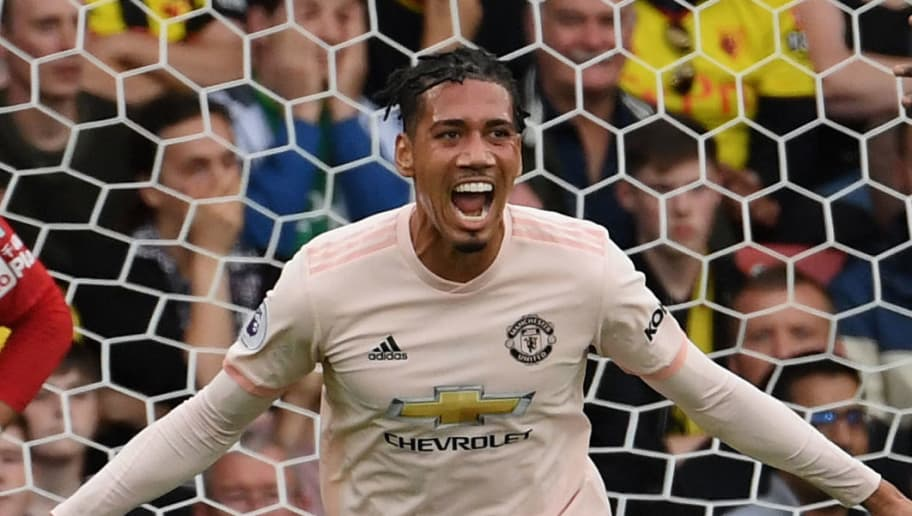 WATFORD, ENGLAND - SEPTEMBER 15:  Chris Smalling of Manchester United celebrates after scoring their second goal during the Premier League match between Watford FC and Manchester United at Vicarage Road on September 15, 2018 in Watford, United Kingdom.  (Photo by Ross Kinnaird/Getty Images)