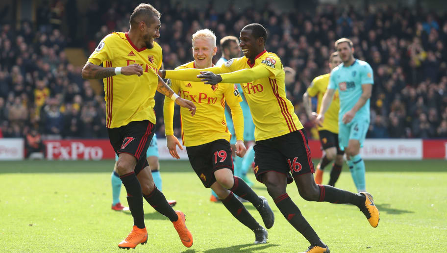 WATFORD, ENGLAND - MARCH 31:  Roberto Pereyra of Watford (left) celebrates after scoring with Abdoulaye Doucoure of Watford and Will Hughes of Watford during the Premier League match between Watford and AFC Bournemouth at Vicarage Road on March 31, 2018 in Watford, England.  (Photo by Christopher Lee/Getty Images)