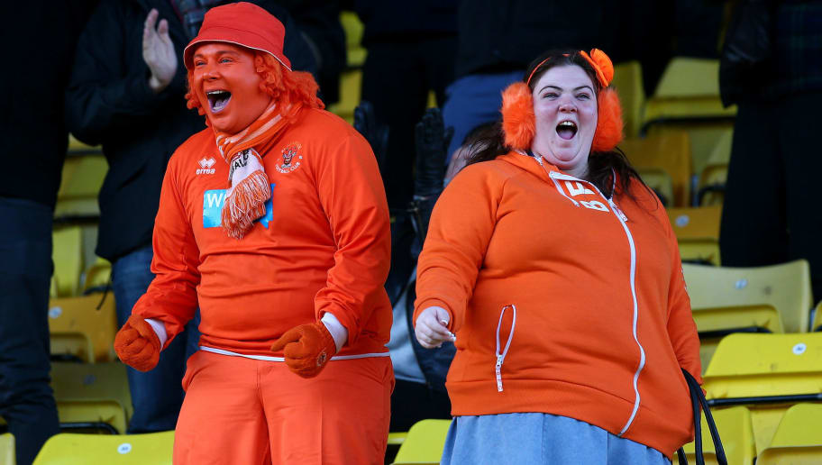 WATFORD, ENGLAND - JANUARY 24: Blackpool supports celebrate the teams second goal during the Sky Bet Championship match between Watford and Blackpool at Vicarage Road on January 24, 2015 in Watford, England. (Photo by Charlie Crowhurst/Getty Images)