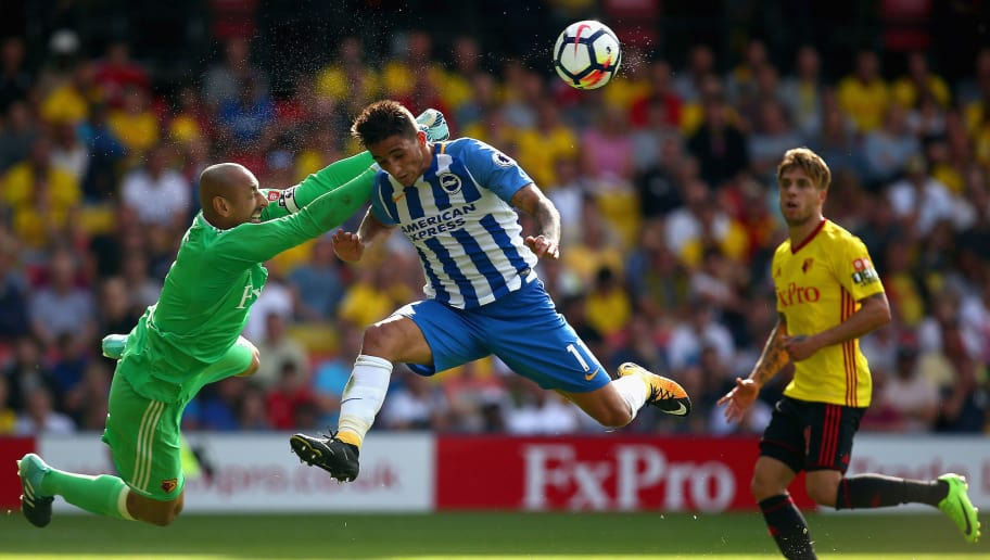 WATFORD, ENGLAND - AUGUST 26:  Heurelho Gomes of Watford punches the ball before Anthony Knockaert of Brighton and Hove Albion can get his head to the ball during the Premier League match between Watford and Brighton and Hove Albion at Vicarage Road on August 26, 2017 in Watford, England.  (Photo by Charlie Crowhurst/Getty Images)